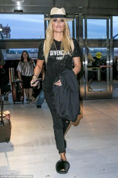 Khloe Kardashian wearing Chanel Spring 2014 Graffiti Backpack, Frame Le Color Rip Skinny Jeans in Noir, Givenchy Mink Fur & Rubber Slides and Givenchy Logo Print T-Shirt
