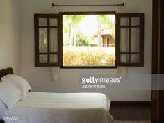 Bedroom with open window : Stock Photo