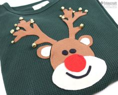 Soon enough we will be cosying up in our jolly Christmas Jumpers so why not craft your own cheerful design using our free template? This cute reindeer added with jingle bells will really capture the excitement of the festive holiday! Christmas Jumper Day, Diy Ugly Christmas Sweater, Tacky Christmas, Handmade Christmas, Christmas Crafts, Ugly Sweater, Christmas Tables, Modern Christmas, Scandinavian Christmas