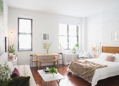 "Homepolish Interior Design | ""My initial idea was to go fully minimalist with a natural wabi sabi-inspired space,"" says Julia about her home design. ""My theory on minimalism, however, is that it tends to get expensive because if you only have three pieces of furniture in your home they better be top of the line. So instead of going that route, I ended up working around two existing pieces that I loved and that I knew I would hold on to, which were my hand-me-down Danish Midcentury nesting…"