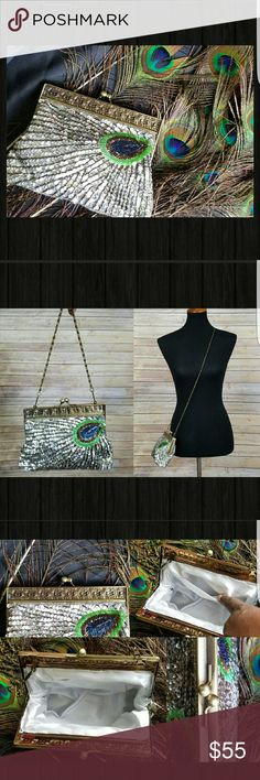 """❤NEW ARRIVAL❤ SILVER SEQUINS PEACOCK CLUTCH NWOT - STUNNING SILVER PEACOCK CLUTCH!  Vintage Style Hardware with a """"Kiss Lock"""" closure and comes with 1- 13"""" Chain and a 46 1/2"""" Chain. Which can be worn as a """"Wrist Clutch"""", """"Shoulder"""" or as a """"Crossbody"""".  6"""" Tall, 8"""" Wide, 1/2 Thick.  This is true STUNNER!   Bags Clutches & Wristlets"""