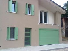Garage doors with a personal touch Custom made garage doors: side hinged, sectional, sliding. Entrance Doors, Garage Doors, Front Entrances, Facade House, Home Photo, Sliding Doors, Curb Appeal, Outdoor Decor, Touch