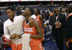 Coolidge's Everett Coker, left, and Issac Blue shake hands after their victory in the DCSAA boys title game. Toni L. Sandys / The Washington Post Ten Games, Calvin Coolidge, Shake Hands, The Washington Post, Victorious, High School, Boys, Sports, Baby Boys