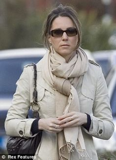 Kate is seen in scarf and shades