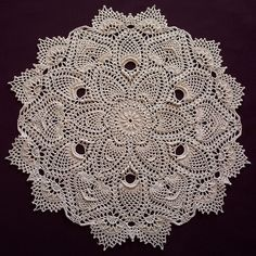 Pineapple doily ....... pattern in   Leisure Arts #3494, Pineapple Gallery