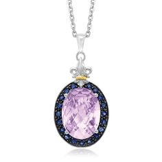 Radiating timeless style, this oval motif pendant showcases a pink amethyst bordered with lovely black sapphire stones. Positively beautiful, this fleur de lis embellished pendant is designed in 18K y