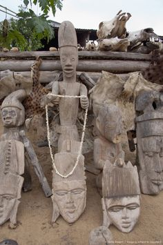 wooden voodoo deity and masks on local market where animal bones, skin and body parts are used in voodoo rituals, Lome, Togo, West Africa