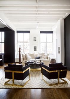 Black and white living room with ceiling beams