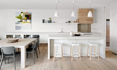 PJP Residence - Mim Design, fantastic dining chairs, light woods, and white kitchen Zen Kitchen, Open Plan Kitchen Dining, Kitchen Stools, Design Kitchen, Kitchen White, Kitchen Wood, Neutral Kitchen, Country Kitchen, Bar Stools