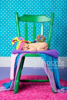 newborn photography pose chair colors green pink purple baby