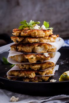 Roasted cauliflower and creamy feta come together to form these kick-ass vegetarian fritters.