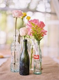 diy centerpieces. Super simple centerpieces...just a bottle and one flower. <3