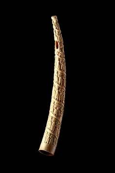 African Angola Loango Coast Ivory Tusk- Originally an old ivory tribal oliphant or trumpet this tusk has been expressively carved with detailed and vivid images of the 19th century European and West African trade in slaves, animals, ivory, fish, timber, rubber and other commodities. It accurately depicts colonial life as it was in the coastal trading stations on the Loango Coast. They are always carved with continuous sp...