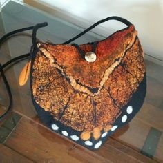 Check out this item in my Etsy shop https://www.etsy.com/listing/482645712/nuno-felted-cross-body-bag-in-black-with