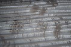 Jess Coetzer Textile artist transparent tubing woven with nylon monofilament. Experimental Textiles.