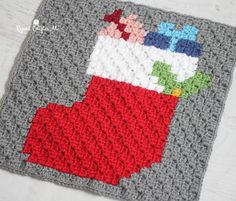 Here it is! The last square in the Crochet Christmas Character Afghan!! The Christmas Stocking (complete with presents sticking out of the top), is another iconic image that couldn't be left out of the blanket. But check back in the next couple daysfor a bonus square and links to some other Christmas pixel square ideas …