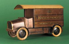 Google Image Result for http://www.planetdiecast.com/hwdphotos/uploads/32253/2526/Huntley_and_Palmer_Delivery_Van_Biscuit_Tin.jpg