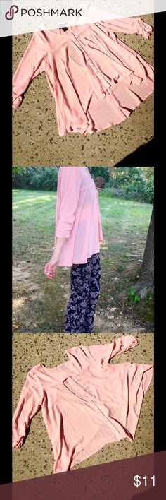 """Peach Super Flowey Shirt Keyhole Back So soft and drappy, semi-sheer, a pinky-peach color, high/low, 3/4 sleeves with some gathering near the sleeve  bottom. Functional front buttons, but you really just drop it over your head. Shortest front 24"""", longest back 28""""' 100% Poly. Armpit to armpit 22.5"""". Gorgeous, but I'm just not comfortable in lighter colors. Worn once. Material Girl Tops Button Down Shirts"""