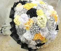 Brooch Bouquet Jeweled Bouquet Wedding Bouquet in Black, White and Yellow. $450.00, via Etsy.