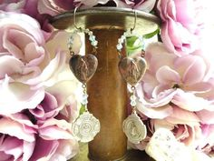 medal assemblage earrings religious shabby chic by lilyofthevally