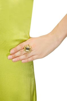 Gold finish floral design ring available only at Pernia's Pop-Up Shop.