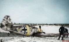 "Bf-109F2 ""Yellow 7"" of Uffz. Döllefeld 9./JG 54 belly lands in the snow."