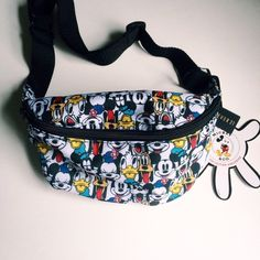 Disney fanny pack Disney characters printed on super cute adjustable fanny pack. I got it for a Disney trip but never used it. It's new. In perfect condition. Tags still attached. (Please excuse the lighting in the last photo. Just wanted to show the size. I'm 5'1 so I'm pretty small) Forever 21 Bags Mini Bags