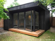 Garden room studio Outdoor office in Barnet with black stained cladding, bi-fold doors and deck Backyard Office, Outdoor Office, Backyard Studio, Garden Office, Outdoor Rooms, Garden Pods, Garden Cabins, Studio Shed, Modern Shed