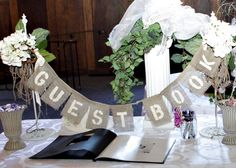 GUEST BOOK Burlap Wedding Sign Photo Prop- With Linen Twill Bows- Shabby chic vintage inspired wedding- Cream, White, Jute Decor. $23.00, via Etsy.