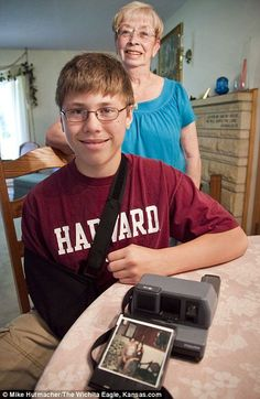 """""""Unexplained: Addison Logan found the old Polaroid camera on sale as he went around garage sales with his grandmother, Lois, in Wichita on Thursday."""" This whole story is just plan freaky and a gift to the family at the same time. I can see someone writing a book/movie already! Amazing story!"""