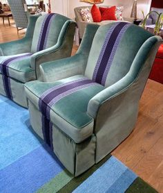 The Enduring Power of Blue at High Point Market, Spring 2014. Wesley Hall updated a traditional look in blues with the fun greek key tape and velvet on a wing swivel chair combination.
