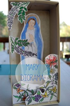 Celeste at Doodle La has done the work so we can have all the fun! Download her pretty picture of Mary (free!) for the kids to color and cut out and voila! A sweet Mary Diorama for your home. Perfect for May.