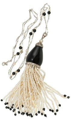 An Art Deco pearl, onyx, diamond and platinum sautoir, by Ghiso, 1920s. The platinum chain accented with pearls and onyx cabochons, suspending an onyx dome cap accented with diamonds, with a tassel of pearls below, each strand of pearls terminating in an onyx bead. #Ghiso #ArtDeco #sautoir #necklace