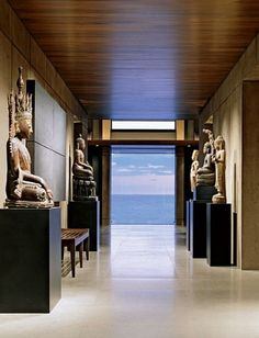 Architect Jim Olson was chosen by a couple seeking a retreat for their seaside property on Hawaii's Kohala Coast. The nature-embracing contemporary expression he created for them, 10,000 square feet in all, draws from concepts rooted in traditional Asian design.In the entrance hall, the Pacific is a constant focal point. The Christian Liaigre tribal bench is from Holly Hunt.