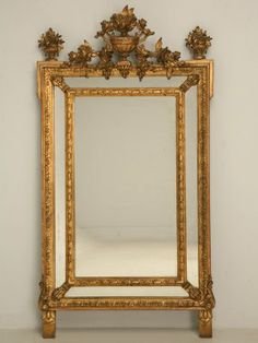 Hand-carved antique French mirror in gilded gesso over wood frame