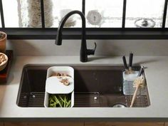 """LOVE this sink in Jonathan Adler's Palermo Blue!  Kohler Riverby 33"""" undermount with custom-fit colander with integral cutting board, a utility rack with soaking cup, and a left-hand, stainless-steel bottom basin rack."""