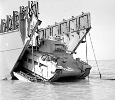 """A12 infantry tank Mk II """"Matilda"""" II i comes ashore from a landing craft during combined operations training involving 5th New Zealand Infantry Brigade at Ras Sudr in Egypt, 9 February 1942."""