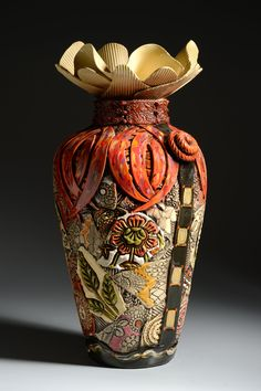 Extra Large Floor Vase with Narrow Bottom by Gail Markiewicz. Hand built of textured and carved clay in a patchwork design. Airbrushed and hand painted with glazes. Each piece is unique. Exact patterning and coloration will vary. Slab Pottery, Pottery Vase, Ceramic Pottery, Pottery Painting, Large Floor Vase, Floor Vases, Hand Thrown Pottery, Pet Urns, Gourd Art