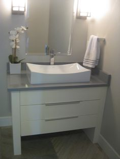 Like vessel sink with curvature; pedestal sink with long contemporary pulls