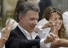 FILE - In this Sunday, Oct. 2, 2016 file photo Colombia's President Juan Manuel Santos makes the victory sign after voting in a referendum to decide whether or not to support the peace deal he signed with rebels of the Revolutionary Armed Forces of Colombia, FARC, in Bogota, Colombia. Colombia's government and rebels from the National Liberation Army have agreed to revive a stalled peace effort, providing a boost to President Juan Manuel Santos as he tries to recover from voters' shocking…
