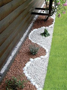 Mix two color of rocks, and use chunky rocks as a border to create a nice contrast.