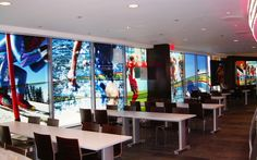 Window graphics can brighten up office environments. These were designed by AMPCO.