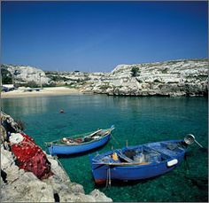 Fishing boats sit in Porto Badisco, in southern Italy's Puglia region, near Lecce. The region has some of the brightest seas.