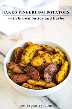 Baked fingerling potatoes tossed with brown butter and herbs make a delicious and easy side. Perfect for your holiday table, these tasty potatoes are full of flavor from nutty brown butter and a mixture of dried herbs. #potatorecipes #potatosides #bakedfingerlingpotatoes #fingerlingpotatoes #pookspantry