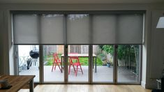 Blfold door blinds. Specialist screen fabrics cover huge areas by Deans Blinds And Awnings. #bifold #door #blinds More