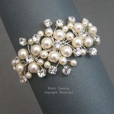 Hand wired swarovski pearls rhinestones floral vine wedding cuff bracelet**  The floral design is made of swarovski IVORY pearls surrounded by NON-TARNISH silver wire wrapped vines encrusted with sparkling rhinestones.    Sizes: approx 3cm at the widest point. $65