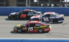 Kurt Busch, Dale Earnhardt Jr. & Clint Bowyer racing side by side at Auto Club Speedway.