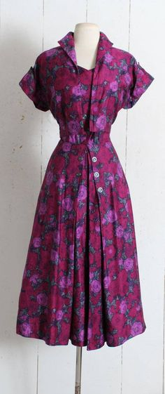 "➳ Vintage 1950s Dress Gorgeous brushed cotton rose print dress in shades of purple. Button front, metal side zipper, subtle pleating at front of skirt, matching bolero jacket. Excellent condition - no flaws. Fits like L. Length 49"" Bodice 19"" Bust 40"" Waist 29-30"" 2 bodice"