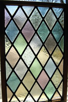 PART OF ANTIQUE stained glass window. $242.00, via Etsy.