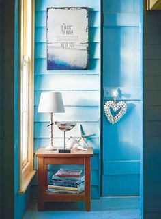 Accessorise your hallway with cheerful, coastal touches – shells, driftwood-effect seagulls and inspiring canvases.
